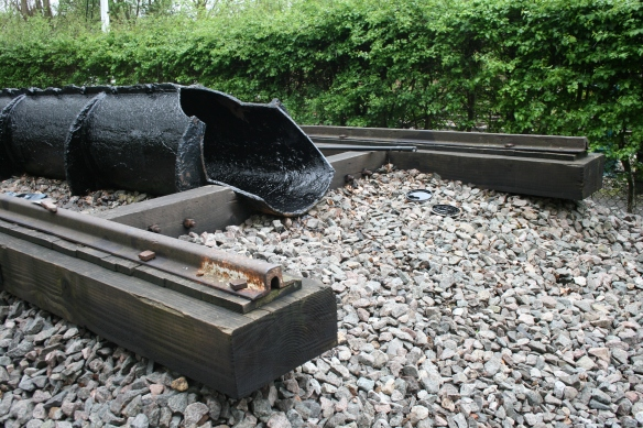 The surviving 1840s atmospheric railway pipe and broad gauge track, at Didcot Railway Centre